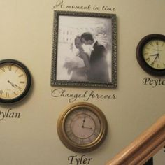 Clocks stopped at the time of birth for each child with a picture of mommy and daddy in the middle! Love!
