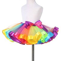 This rainbow skirt with a large bow is the base of your child's JoJo Siwa DIY Halloween costume.