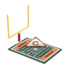 """Chicago Bears Fiki Football: For decades millions have folded a sheet of paper into a triangle """"football"""" sliding it back and forth across a table in an attempt to score a touchdown. An opponent's outstretched fingers forming a goalpost for field goals and extra points. Today the game is called FIKI Football and features the NFL logo of your favorite team.  $7.99  http://calendars.com/Chicago-Bears/Chicago-Bears-Fiki-Football/prod1279099/?categoryId=cat00486=cat00486#"""