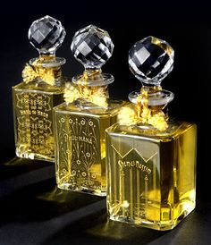 Crystal perfume bottles with cut crystal stoppers