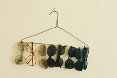 Smart way to store you sunglasses. I would fix the hanger to look a little bit sassier....