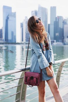 Andy Torres wearing a denim dress and Phillip Lim bag in Singapore Singapore Travel Outfit, Singapore Fashion, Singapore Singapore, Phillip Lim Bag, Style Scrapbook, Macbook Air, Outfit Of The Day, What To Wear, Cool Style
