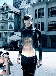 Ok, so this is just a dude with a lot of body paint - but I like the inspiration for something made with a sheer, nude, longsleeved top and some fabric paint to get the effect.