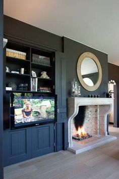 Fireplace with built in cabinet for tv to the side of the fireplace, not the best example but gives an idea on layout