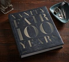 Since its creation 100 years ago, Vanity Fair has presented the modern era as it unfolds, showcasing personality and power, art and commerce, crisis and culture. Best Coffee Table Books, Fashion Coffee Table Books, Fashion Books, Office Storage Furniture, Graydon Carter, Wall Candle Holders, Curtains For Sale, Frame Wall Decor, Wall Art