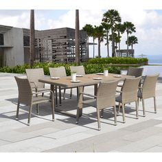 @Overstock - Sirio Ashena 9-piece Wicker Dining Set - This lovely outdoor set includes eight tightly-wrapped wicker chairs along with a table composed of poly wood slats for the tabletop with broad U-shaped wicker legs. The grey set is weather resistant for long lasting.  http://www.overstock.com/Home-Garden/Sirio-Ashena-9-piece-Wicker-Dining-Set/8915342/product.html?CID=214117 $1,543.99