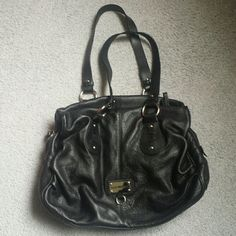 Mint conditions Italian Leather black purse This purse comes from Italy, brand is Nuovedive. Very soft pebble leather, lots of pockets with zippers that run all smoothly. Very clean both inside and outside, no odors! 16 inches long, 11.5 inches tall, 5 incjes inches deep. Black with silver hardware. Nuovedive Bags Shoulder Bags