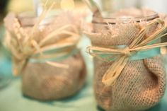 mason jars wrapped in burlap, twine and but with purple ribbon..inspiration!!
