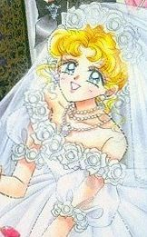 """Usagi Tsukino's wedding dress from anime & manga series """"Sailor Moon."""" It features off the shoulder puffed sleeves with rosette trim."""