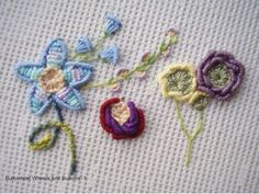 I ❤ embroidery . . . Tast2,week 6 - Buttonhole bullion eyelet flowers. Edmar Lola in blue and perle 8 and 12 for the other flowers. Tiny ones were stitched with 2 DMC strands.