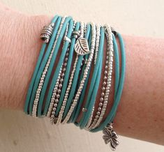 Boho Chic Endless Light Turquoise Leather  Wrap by DesignsbyNoa, $42.00 Boho chic, turquoise leather wrap bracelet is made with 4 cords of light turquoise leather. I have added silver tone crimp beads, tibetan beads and charms. Charms can be changed. There are two strands of handbeaded miyuki beads (japanese glass) in silver and a silver tone chain. A decorative toggle clasp finishes this piece.