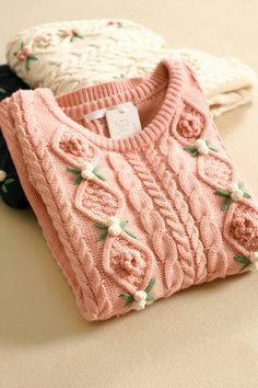 (link goes to taobao) this would be an easy diy upcycle for a thrifted ribbed sweater- you could make the little roses yourself or buy them online for cheap!