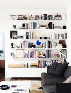 The Design Files, white bookshelves painted the same color as wall, shelves above console Home Living Room, Living Spaces, White Bookshelves, Bookcases, Bookcase Shelves, White Shelves, Modern Bookcase, Muebles Living, Melbourne House