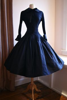 Vintage 1950s New Look silk taffeta dress by Matthew Fox. Available at Xtabay.