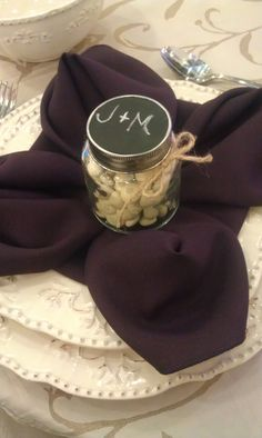 Candy in a small jar, lid painted with chalkboard paint, initials =wedding favor!