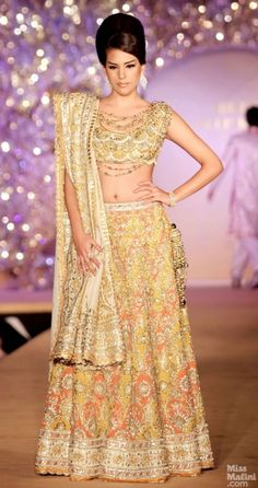 Yellow lengha. Abu Jani and Sandeep Khosla presents The Golden Peacock Collection.