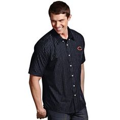 3a5a0ff32 This collared shirt boasts an embroidered team logo on the left side above  a ...
