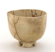 Lacquer and gold repairs hold together the pieces of this elegant Japanese stoneware tea bowl.
