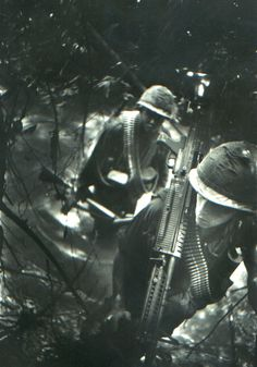 173rd Airborne Brigade soldier with M60 slogs it up a hill in the jungle - Vietnam War