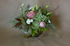 Arrangement. Centerpiece. Wedding. Pink, Green, White, Burgundy. Garden Roses. Spray Roses. Succulent. Greens. Natural. Juniper.  www.forestandfieldcreative.com