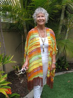 $48.99 Fringed Kimono Style Jacket in brilliant colors of yellow, orange, lime green, lavender and rust...with rust color fringe/  Polyester chiffon.  Easy care and great for travel!  Find at: fayemaxwellcalifornia.com