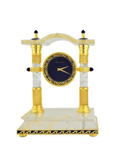 Royal Insignia's rock crystal clock with lapis lazuli clock face. Gilded in 18K gold.