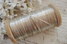 Fabulous Authentic Antique Vintage 1900s French Metal Metallic Embroidery Thread Sparkly Sterling Silver Shade ~ Real Metal Thread Flat, Wide & Tightly Woven Metal Thread Floss Nice weight and High Metal Content. This old thread has a white cotton or silk core thread with flat