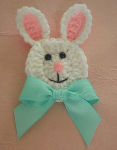Free Crochet Easter Bunny Pattern per the site: I am using mine as napkin ring holders for Easter. Glue a pin back on them to wear as a brooch for Easter, use as appliques on a t-shirt, use them after Easter on baby gifts or blankets, add a hanger and use them on an Easter tree, or hang them on a gift bag or gift box. Theres a pix of them as napkin rings on the site--very cute.
