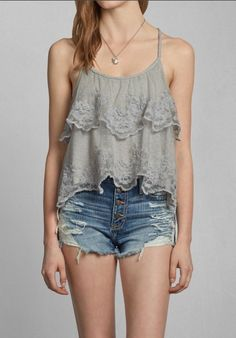 Ruffly gray tank paired with denim shorts