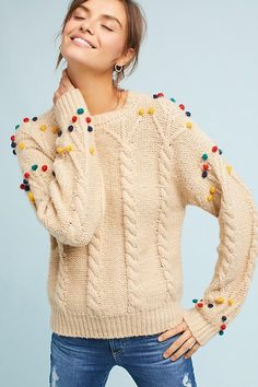 Ceris Pom-Pom Jumper. Colourful pompoms add a playful twist to this everyday cableknit sweater.