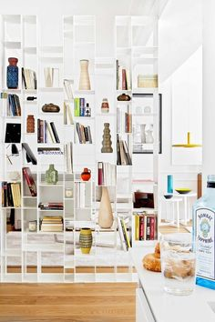 A portable bookcase like this would be multi-useful in a rental - living room / bedroom divider, bathroom / kitchen storage...and gorgeous display space