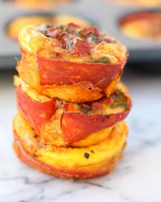 Pepperoni Pizza Egg Cups  hey guys Kelly here from @eatthegains again. Today we are talking about egg cups with a pretty solid flavor  pizza. Anyone else agree  my boyfriend loves pizza. He can eat it just about anytime of the day. One time I went out of town for just one night and he ordered 2 pizzas for himself just so he could have leftovers for the week. I created this recipe with him in mind  each cup packs some protein healthy fats and gives you that pizza taste minus grains and dairy…