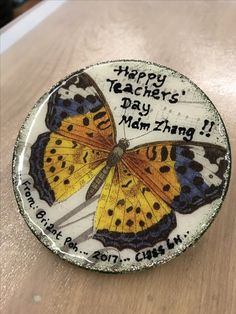 A Teachers' Day magnet - decoupaged with butterfly print