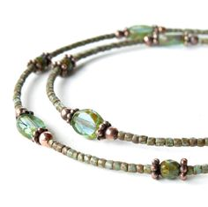 Glass bead necklace - 20.5 inches of delicate aqua, turquoise and copper beads are strung on sturdy coated wire in this versatile matinee length