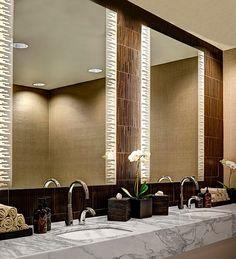 Design Idea! These unique lighted mirrors illuminate the restrooms at the Corbu Spa & Salon in Cambridge, Mass.