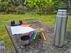 My outdoor office in the park today  #outdoor #office #nature #park #green #table #bench #seat #grass #Australia #summer #work #paper #thermos #pens #headphones #concrete #alternative #planb #cup #coffee #followme #christmas #instawow #instawork