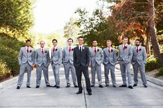 Dark gray suit for groom & light gray suits for groomsmen