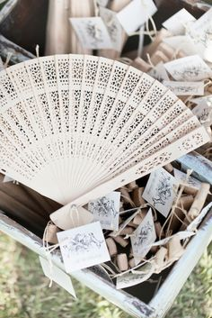 Vintage fan favors: http://www.stylemepretty.com/2015/06/28/vintage-inspired-wedding-details-we-love/