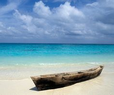 The Indian Ocean archipelago of Zanzibar, off the east coast of Tanzania, is steeped in a romantic history of traders, e. Dugout Canoe, Zanzibar Beaches, Stone Town, Archipelago, Beach Fun, Tanzania, East Coast, Wonderful Places, Pictures