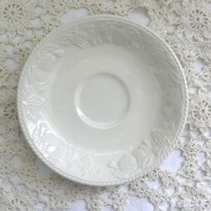 Made from the 1980s Lincoln vintage tea saucer from British Home Stores Replacement BHS crockery in white with fruit and vines embossed onto the sides