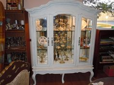 For sale at Estate ReSale & ReDesign $238.  A marriage of two pieces RePurposed coffee table and china cabinet hutch top, wonderfully worn finish.  Recycle, Upcycle!