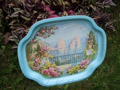 The view presented on this metal serving tray looks like paradise! Id like to be transported to this beautiful location!    Tray is showing