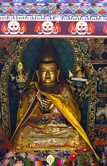 Statue of Tsongkhapa, founder of the Gelugpa school, on the altar in his temple (his birthplace) in Kumbum Monastery, near Xining, Amdo), Tibet.