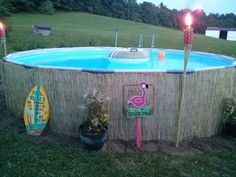 Our Intex Pro Series 14' pool dressed up with bamboo reed fencing from Home Depot! I love the tropical look!!