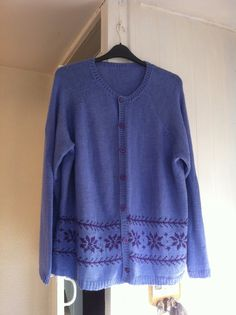 I made this cardigan, with a Nordic style pattern, but in a modern colour scheme - my favourite colours blue with a hint of lilac and purple embellishments.