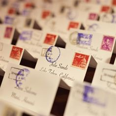 Barbara designed and printed the mail escort cards with stamps and vintage stamps.