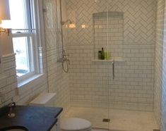 Heading into darker territory, subway tile offers a graphic new look for kitchens, bathrooms and more