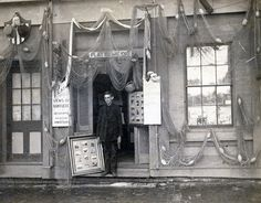 Photographer Harry Platt, Nantucket photographer, standing in the doorway of his store, most likely on Centre Street, c1880s.