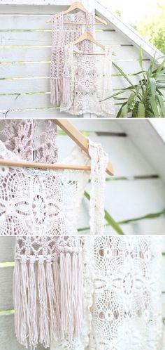 brides maids wear pale shades of purple dresses with crochet vests over them, babys breath bouquets