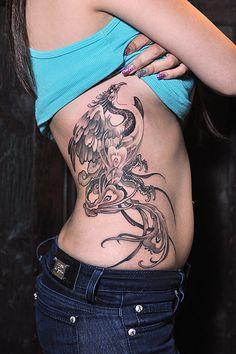 Toronto tattoo shop - phoenix tattoo on ribs